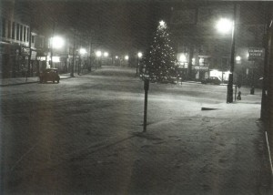 A solitary Christmas tree graces Franklin Square on Christmas Eve during World War II.