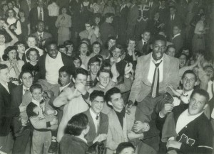 "After beating Bulkeley, NFA students rally in Norton Gym holding John Marshall (left) and Don Scott (right) high as they were the starts of the game. Photo from page 8 of Bill Stanley's 'Once a Upon a Time"" Anniversary Issue"